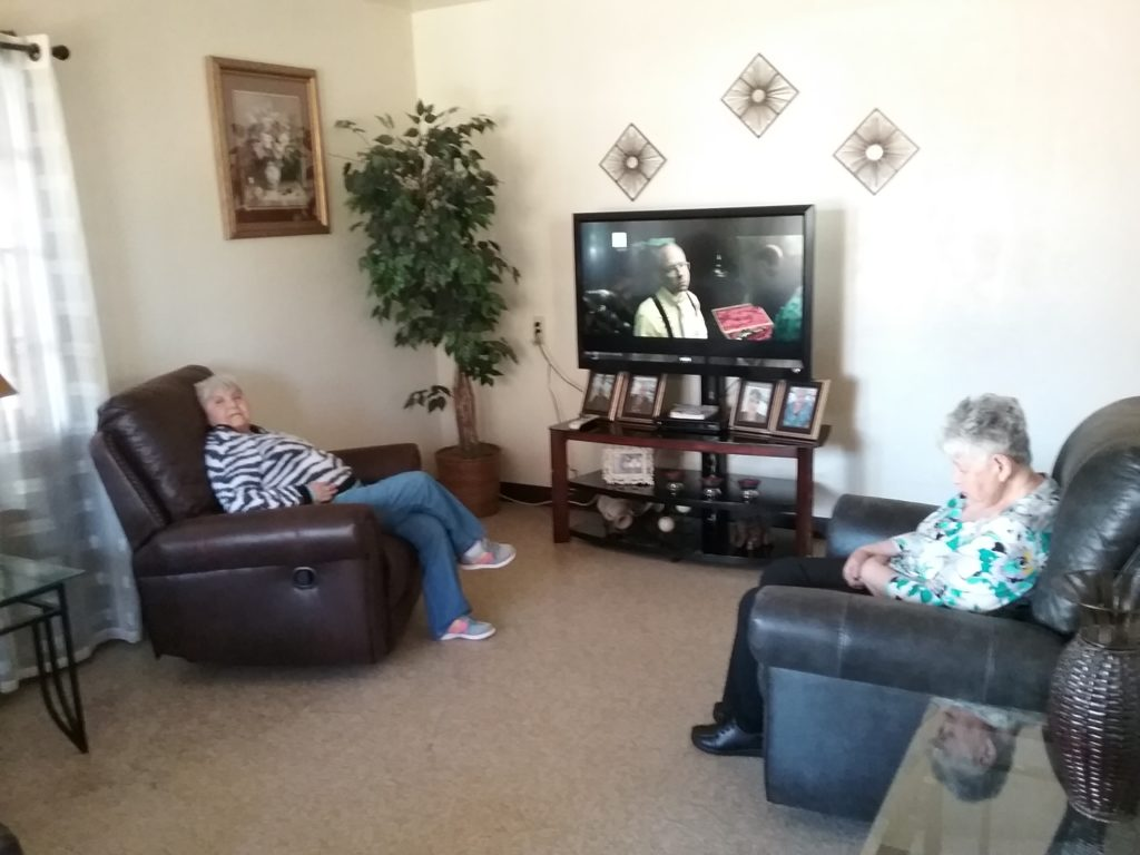 Ladies watching tv at retirement group home