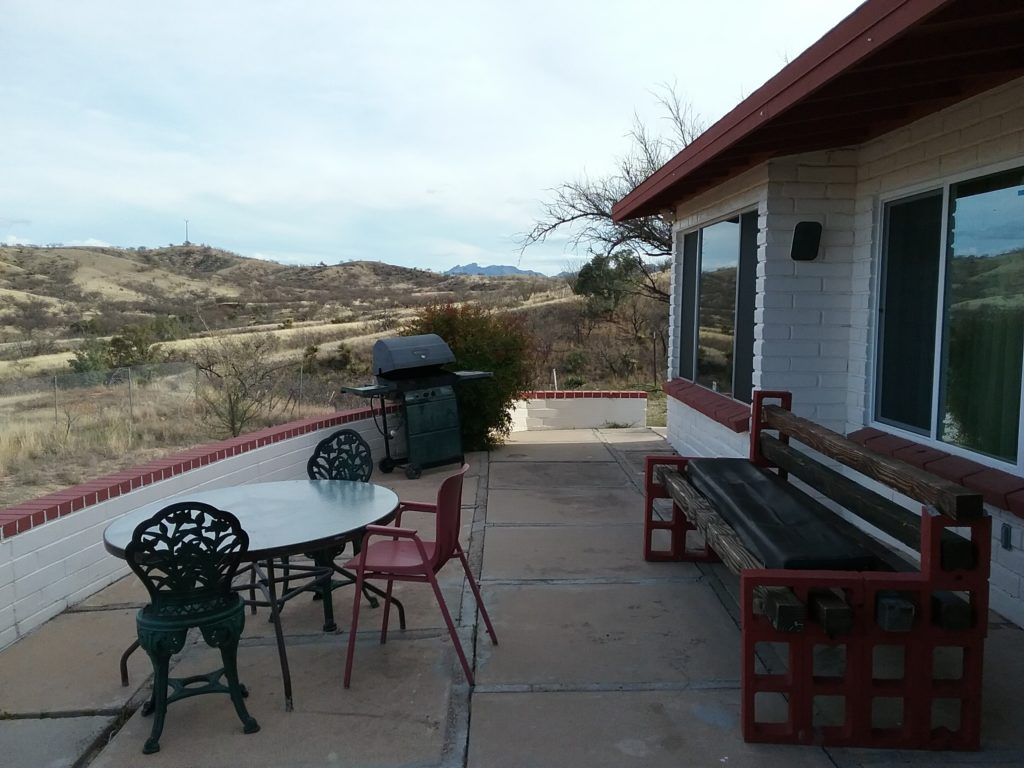 Front porch with grill at group home on Patagonia Highway